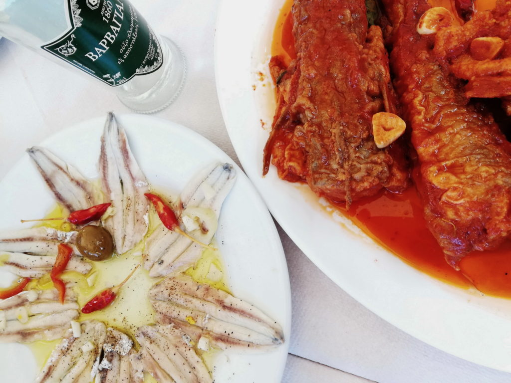 Marinated anchovies and fried fish in tomato garlic sauce are local specialties