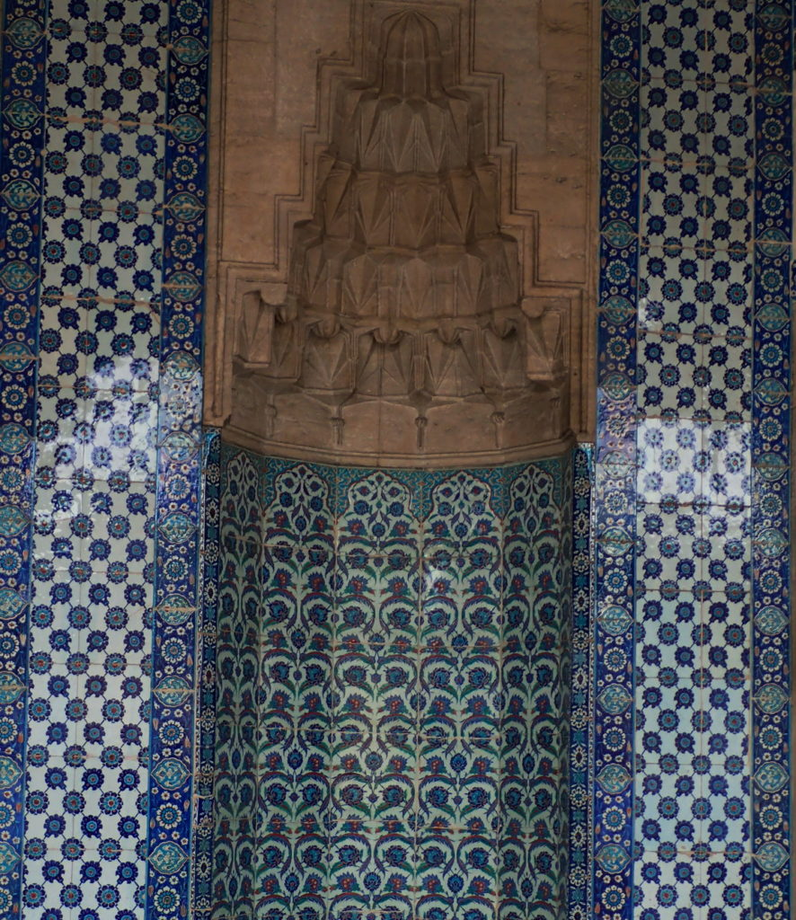 A tiled niche with muqarnas at the Rüstem Pasha Mosque by Mimar Sinan