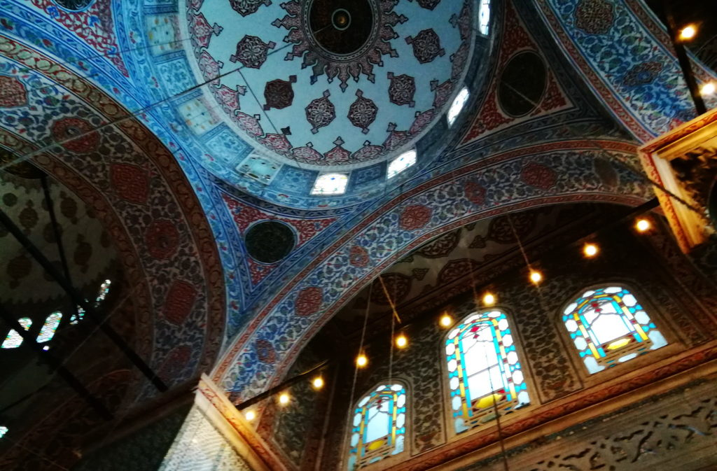 Arabesques and complex geometries decorate the interior of the Blue Mosque