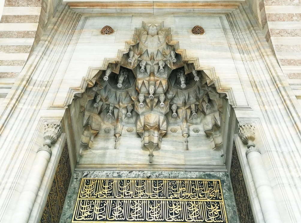 Muqarnas vaulting and calligraphy at the entrance of the Süleymaniye Mosque - Mosque Architecture