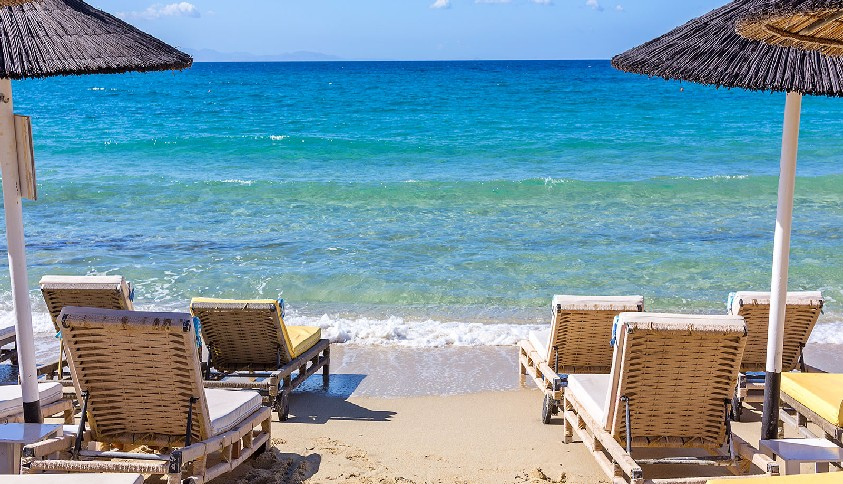 Best things to do in Mykonos - Relaxing as the waves lap the shore