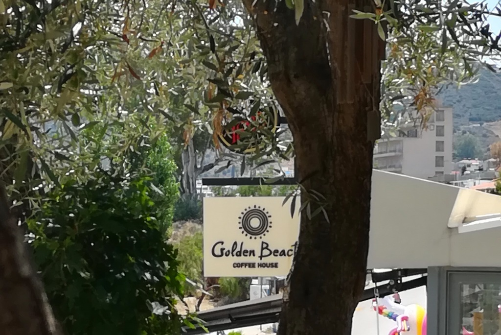 Amid the Olive Trees at Golden Beach, one of the best restaurants in Tolo