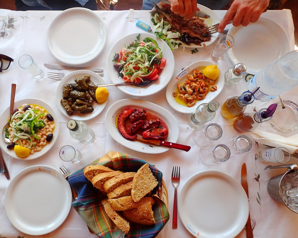 Greek drinks - always with food. Here, a table full of ouzo meze, Skala Kalonis, Lesvos