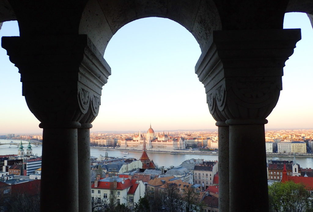 Budapest's Neo-Romanesque Fisherman's Bastion frames the Hungarian Parliament building across the Danube.