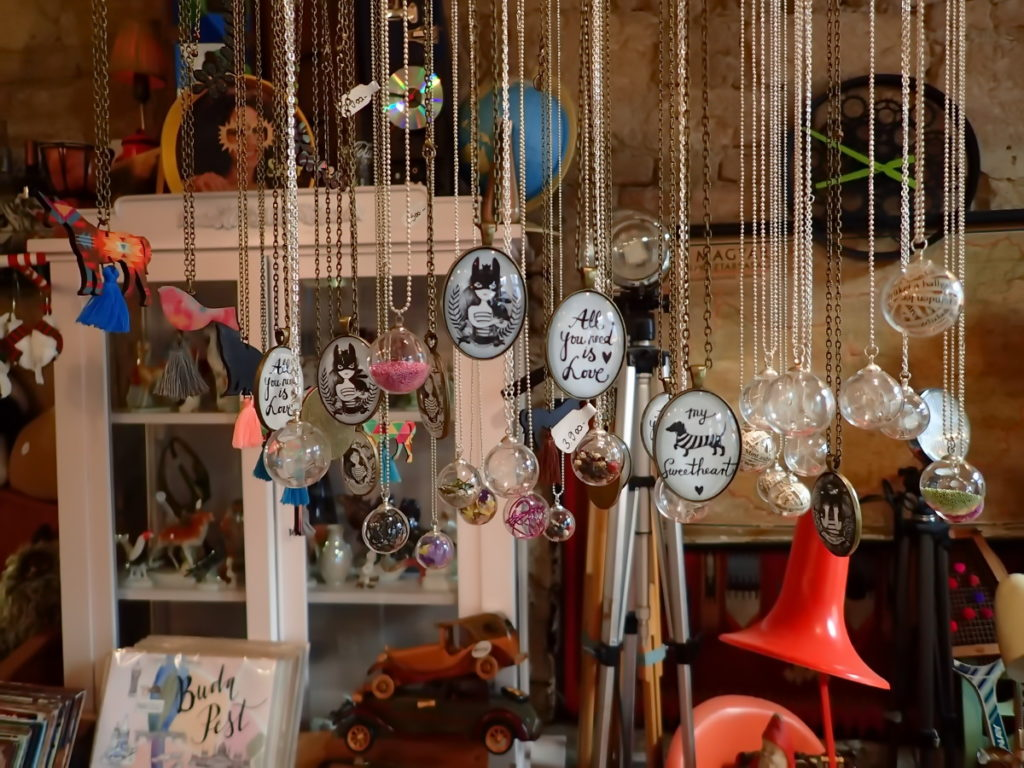 A row of necklaces and other deign objects at Szimpla Kert's shop