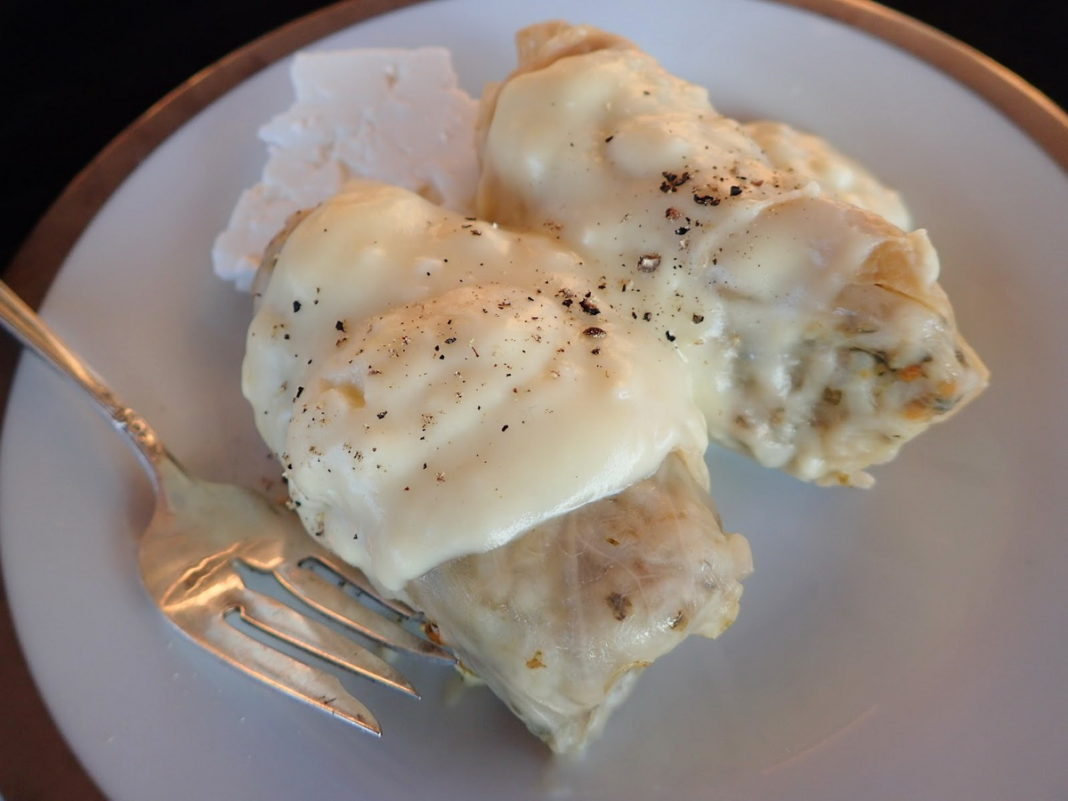Greek Cabbage Rolls with Avgolemono sauce and feta cheese on the side