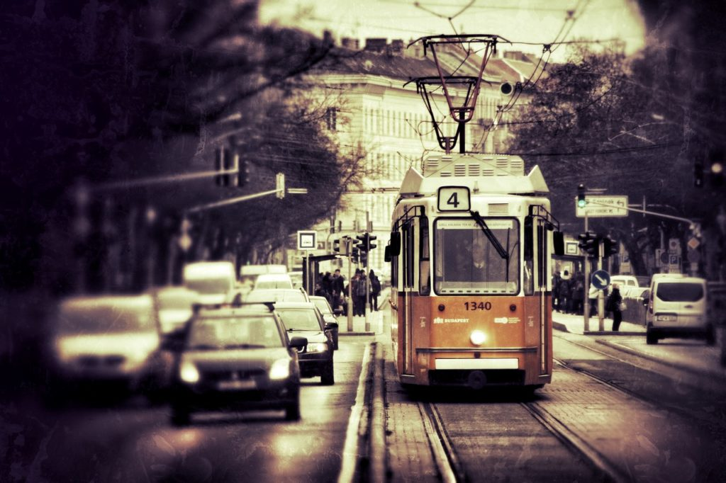 The old-fashioned yellow trams are  stylish and efficient way of getting around in winter in Budapest