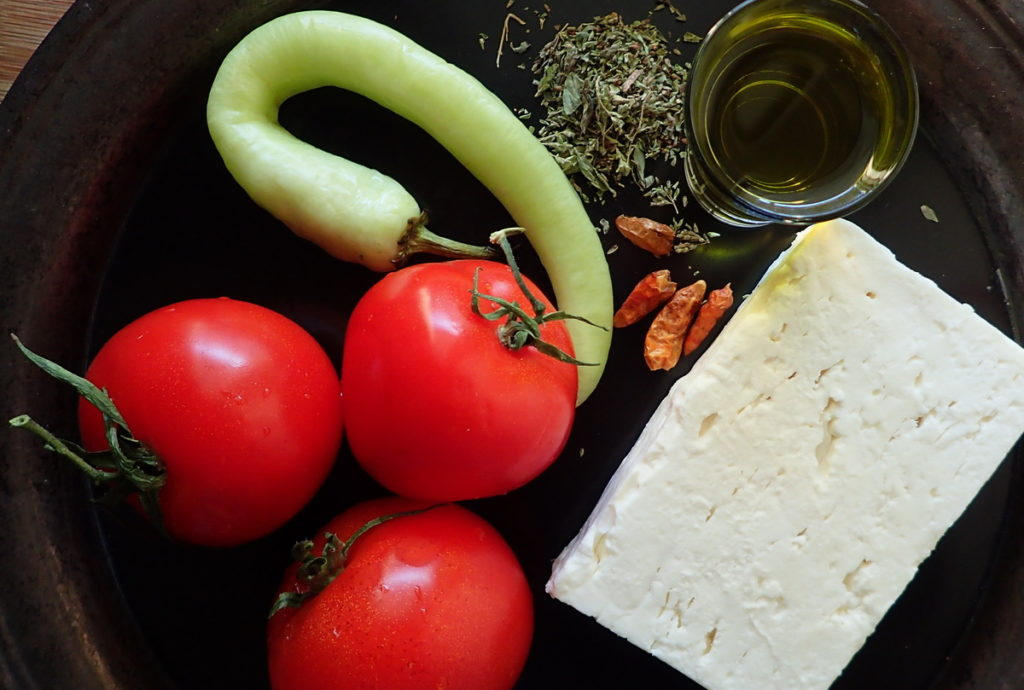 Bougiourdi ingredients - Feta and tomato, plus peppers - both Fresh and dried - for heat, and extra virgin olive oil and wild oregano to finish.