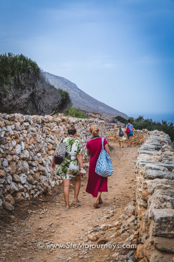 Elena of Passion for Greece and I, as we walk along a rocky path to the Mycenaean excavation.