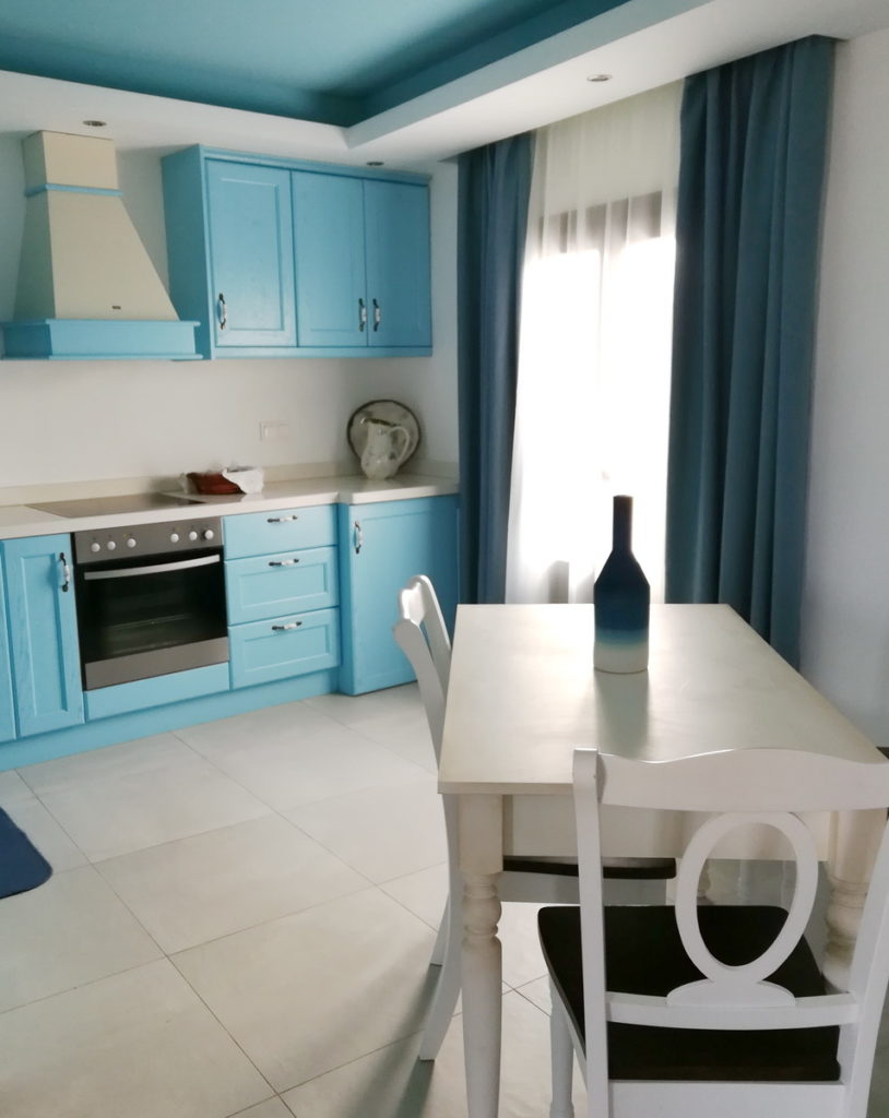 The full modern kitchen in our apartment, in dodecanese blue and white