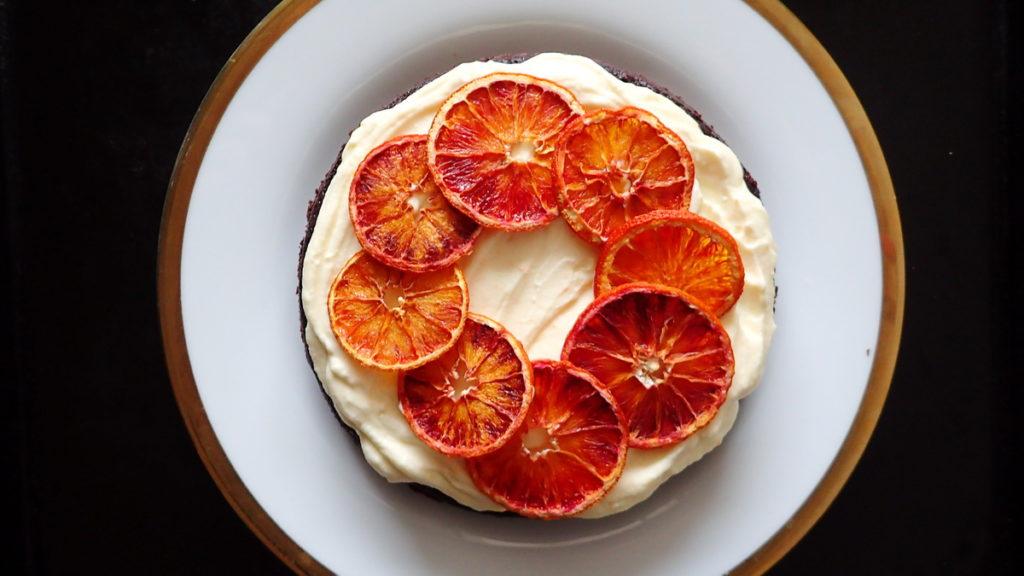 Orange Chocolate Cake with White Chocolate Cream Cheese Frosting and Dried orange segments