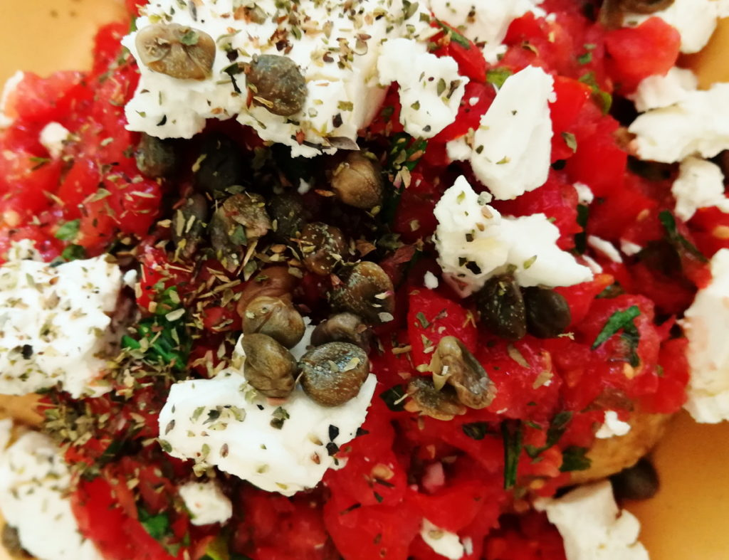Salad with wild capers and herbs from the island