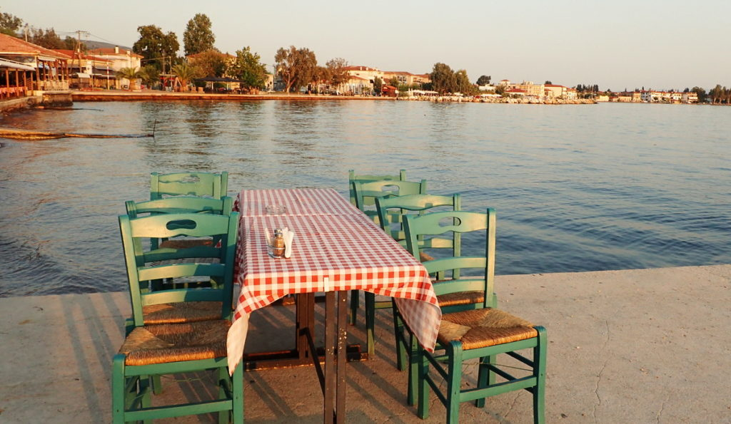 A quiet moment before the evening rush at a seaside tsipouradiko in Agria, Volos - Tsipouro: The Traditional Greek Spirit - Provocolate