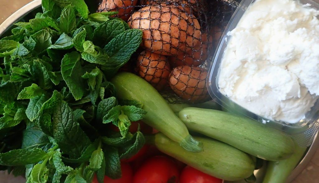 Fresh produce and tangy pichtogalo - Cretan goat cheese - for boureki