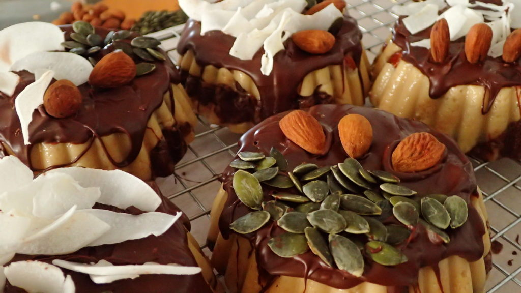 Sesame halva topped with pumpkin seeds, coconut shards, and toasted whole almonds
