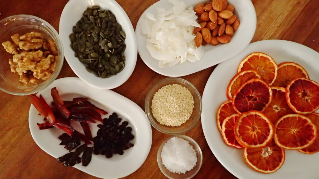 Ingredients for Topping Mendiants - almonds, pepitas, coconut, sea salt, dried orange slices, raisins, dried plums