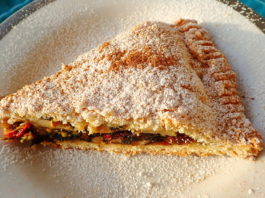 A slice of tourte aux blettes with sugar and cinnamon