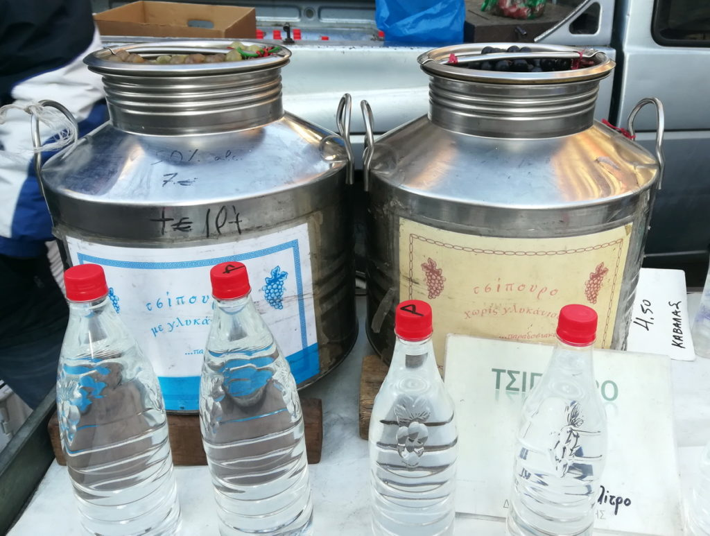 Tsipouro straight from the producer at a weekly farmers' market in Thessaloniki